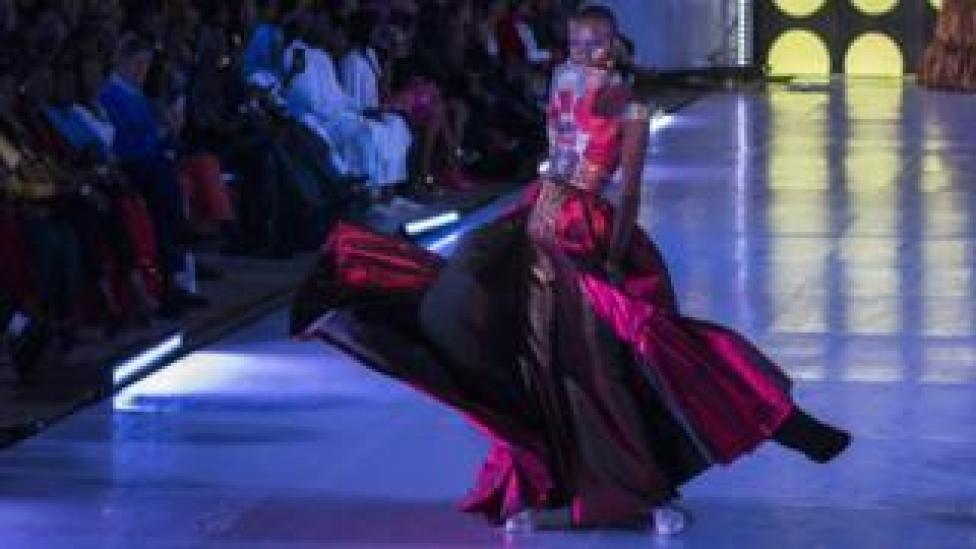 Senegalese model Alima Diop poses on the catwalk wearing a design by Algaye during Dakar Fashion Week in Dakar, Senegal