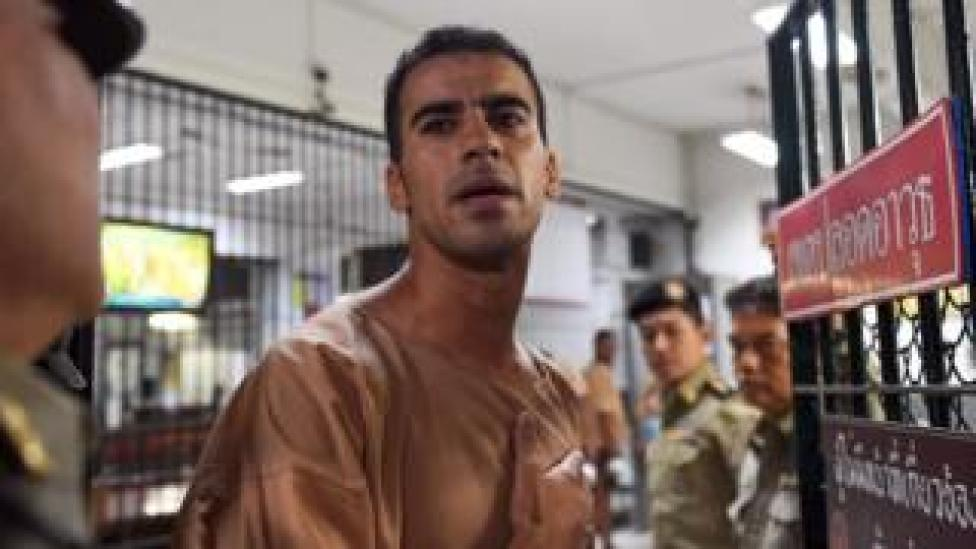 In this file photo taken on February 04, 2019 Hakeem al-Araibi, a Bahraini refugee and Australian resident, is escorted to a courtroom in Bangkok. - Thailand has ended the extradition proceedings against refugee footballer Hakeem al-Araibi on February 11, a prosecutor said