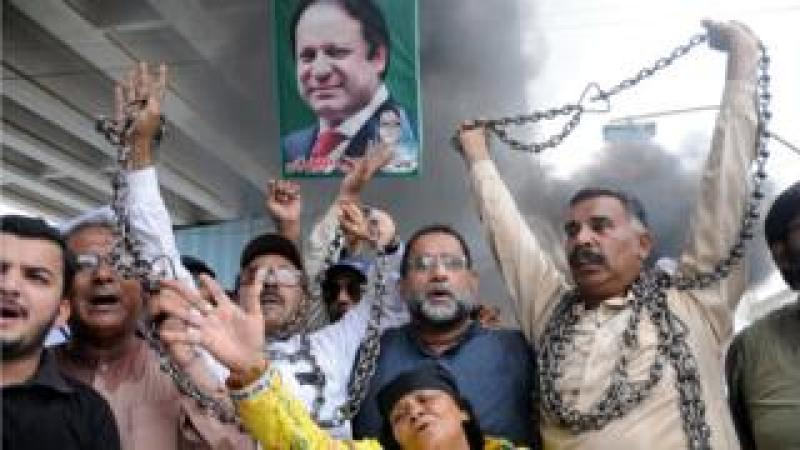 Supporters of Nawaz Sharif shout slogans a day after he was sentenced to 10 years in prison