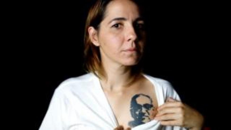 NEWS Salvadoran documentalist filmmaker Marcela Zamora shows her tattoo of the late Archbishop of San Salvador