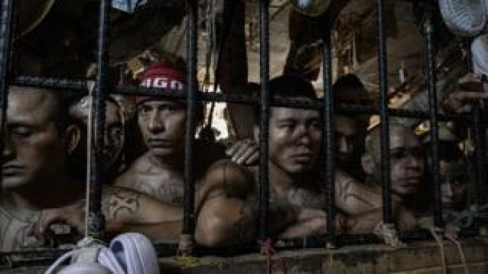Detainees watch in an overcrowded cell at the Quezaltepeque Criminal Center, El Salvador. November 9, 2018