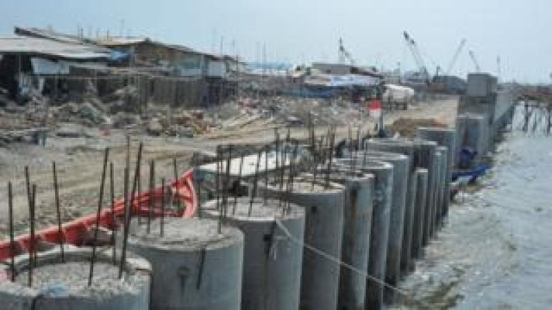 Picture of the unfinished construction of the sea wall
