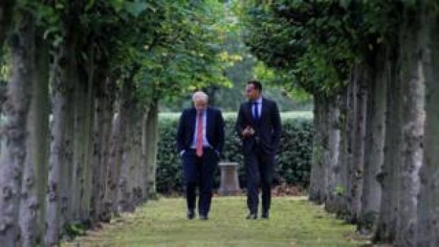 Boris Johnson and Leo Varadkar walking in the grounds of Thornton Manor