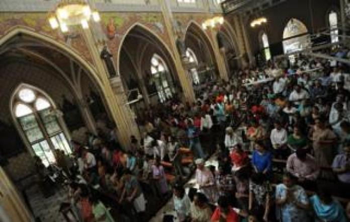 Indian Catholics pray during Friday afternoon service at the Holy Name Cathedral in Mumbai on 15 March 2013.
