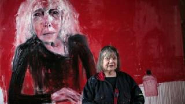 Shani Rhys James pictured in front of a painting depicting her mother