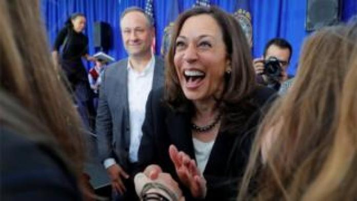 US Senator Kamala Harris (D-CA), with her husband Douglas Emhoff at her side, greets audience members during a campaign stop at Keene State College in Keene, New Hampshire, U.S., April 23, 2019