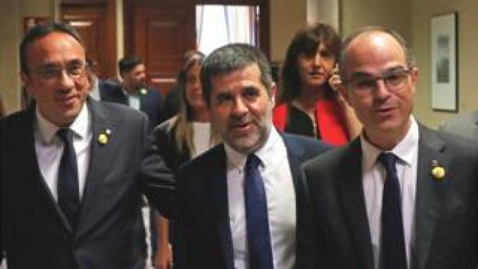 Catalan politicians (L-R) Josep Rull, Jordi Sanchez and Jordi Turull registered on 20 May as MPs