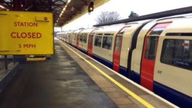 An empty Piccadilly line train stopped at Stamford Brook underground station