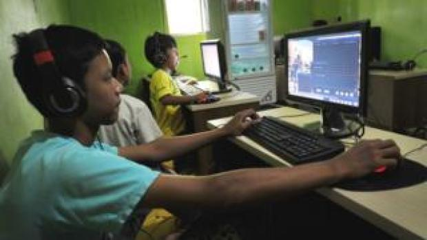 Indonesian boys use computers at a public internet service in Jakarta (file image)
