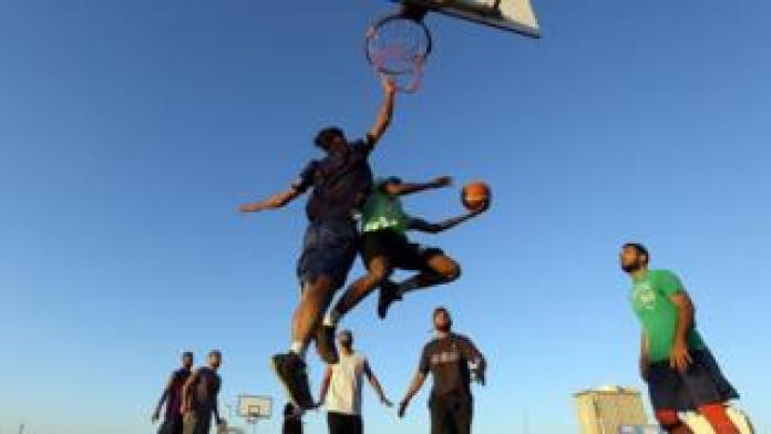Young men play basketball - Monday 27 May 2019