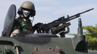 An Indonesian military officer operates an armoured vehicle during Christmas and New Year security preparations in Denpasar, Bali, Indonesia, 22 December 2016.