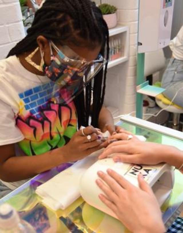 Kadimah Aaliyah works on Kwasi Ritchie-Row's nails