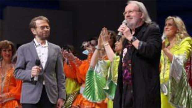 Bjorn Ulvaeus (left) and Benny Andersson on stage with Mamma Mia cast members at the Novello Theatre, London