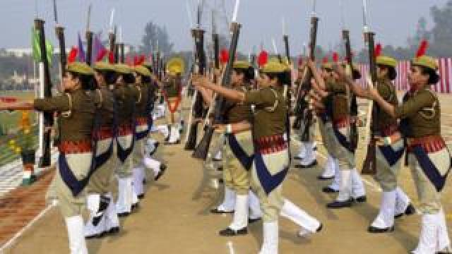 Police personnel take part in a Republic Day parade with Lee-Enfield .303 rifles in Noida on 26 January 2020.