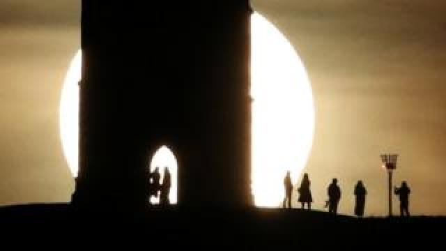 Full moon seen by Glastonbury Tor
