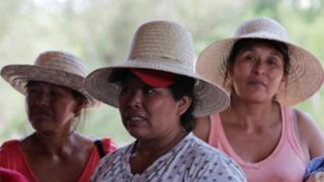 Women attend a meeting during their protest march near San José