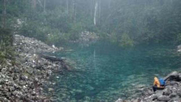 The Disappearing Tarn filled with blue-green water on Mt Wellington in Tasmania