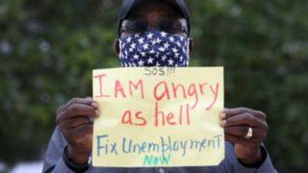 a Florida man protests gaps in the unemployment system