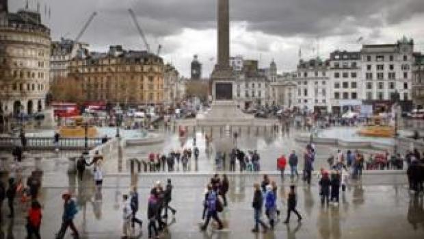 Tourists in Trafalgar Square