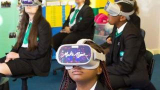 Children with VR headsets on