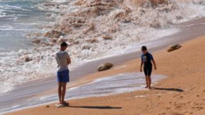 Tourists on a beach in the Algarve