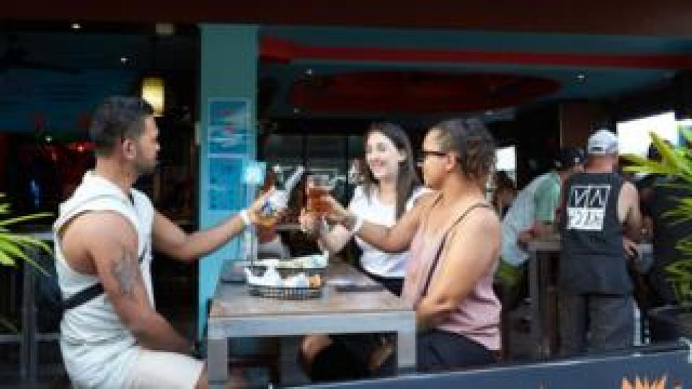 A group of drinkers at a pub in Darwin