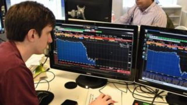 Trader looking at screens