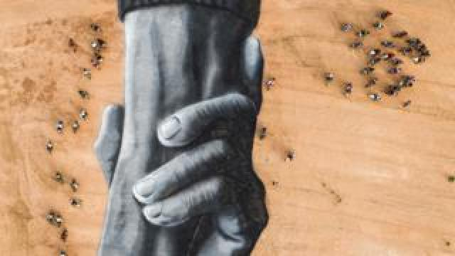 Motorcyclists surround French artist Saype's Beyond Walls artwork of interlocking hands in Ouagadougou, Burkina Faso - Sunday 1 March 2020