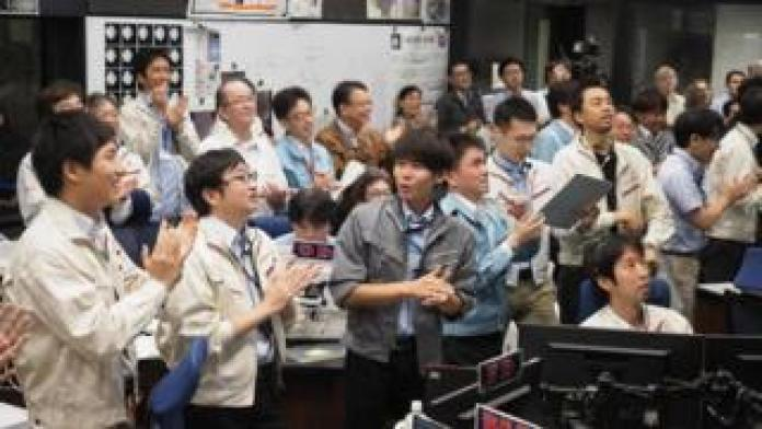Japanese scientists celebrating