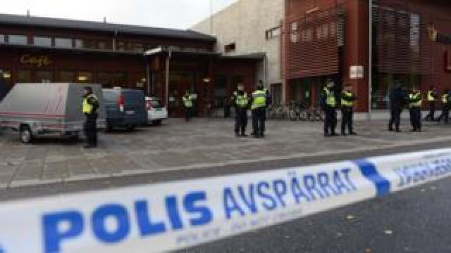 Police work at the scene of a primary and middle school in Trollhattan, southwestern Sweden