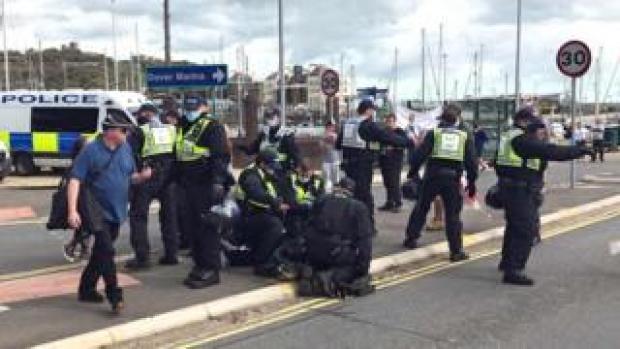 Police restrain protester