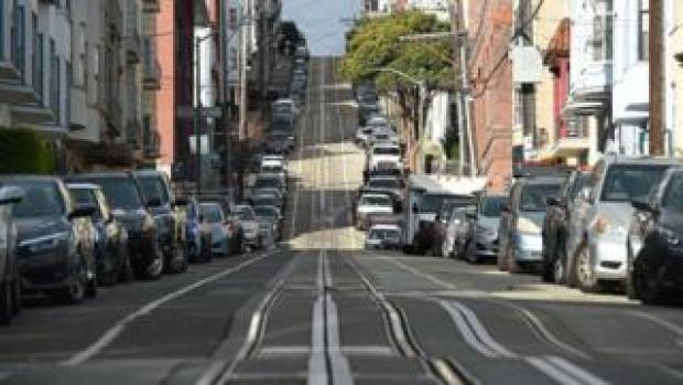 Washington Street, usually filled with iconic cable cars, is seen mostly empty in San Francisco