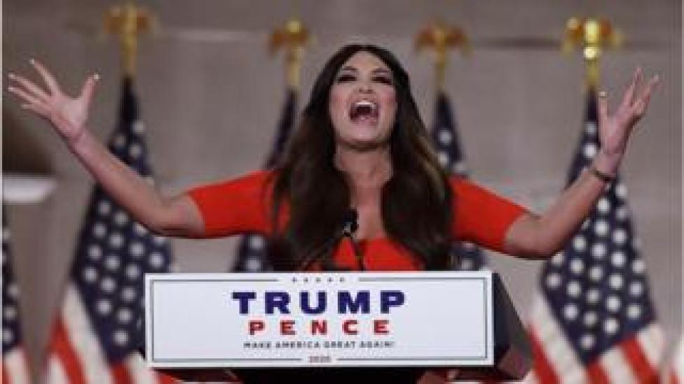 trump Kimberly Guilfoyle holds outstretched arms as she speaks in Washington DC