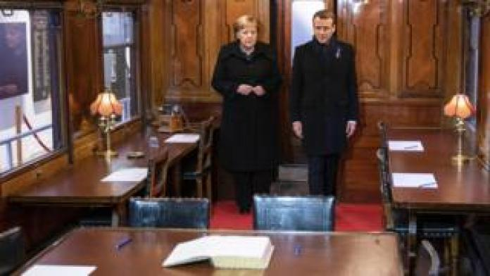 German Chancellor Angela Merkel and French President Emmanuel Macron inside the train carriage in which the ceasefire agreement between the German Reich and France was signed on 11 November 1918