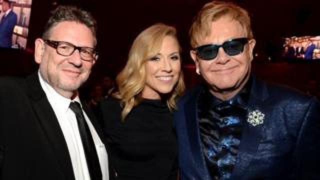 Sir Lucian Grainge (left) with Sheryl Crow and Elton John