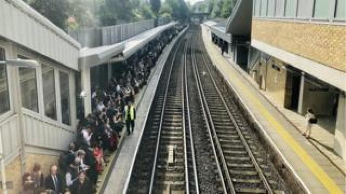 Passengers waiting for trains at Putney