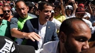 Venezuela's opposition leader Juan Guaidó (centre) at a rally in Caracas. Photo: 12 February 2019
