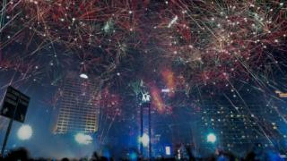 Fireworks explode during New Year's celebrations in the business district in Jakarta, Indonesia January 1, 2018 in this photo taken by Antara Foto.