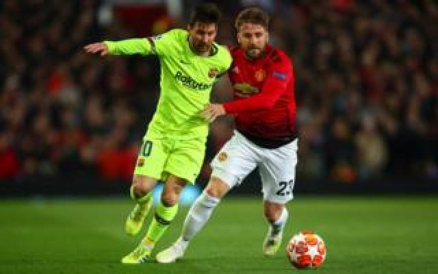 Lionel Messi of FC Barcelona and Luke Shaw of Manchester United during the UEFA Champions League Quarter Final first leg match