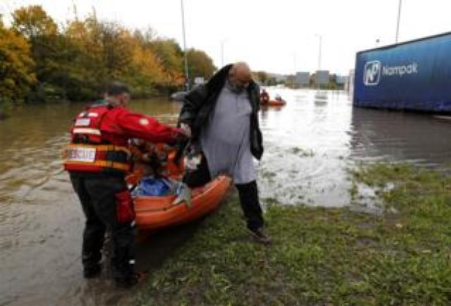 A man is rescued from flood waters