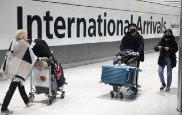 Passengers arrive at Heathrow Airport in London after the last British Airways flight from China touched down in the UK on Wednesday 29 January, 2020.