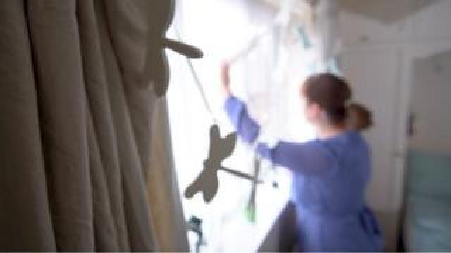 Woman at window, blurred shot