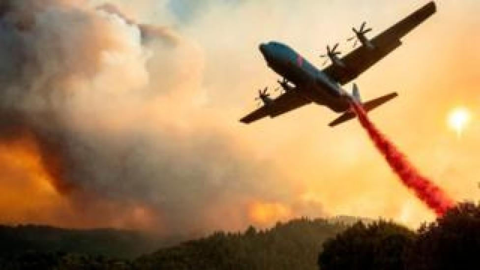 An aircraft drops fire retardant on a ridge during the Walbridge fire in California on August 20, 2020.