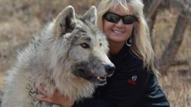 Peggy and her wolfdog Kalani