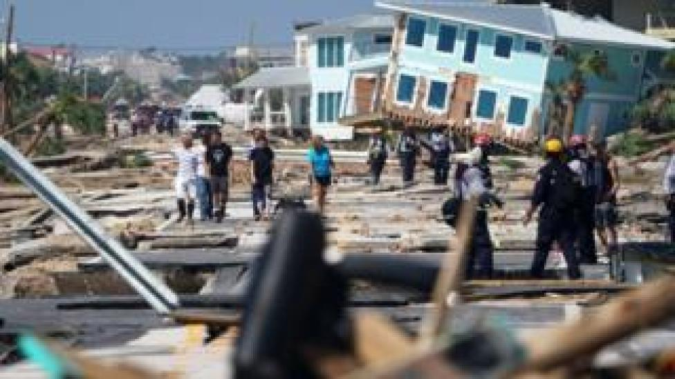 NEWS Mexico Beach residents walk down a street on Thursday