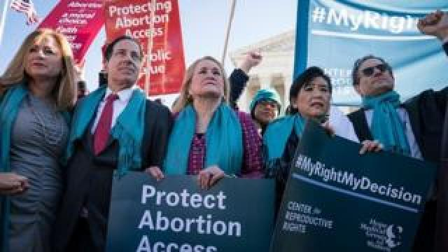 Protesters participate in an abortion rights rally outside of the Supreme Court in Washington