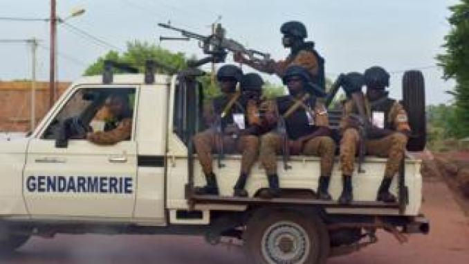 Burkinabe gendarmes sitting on their vehicle in the city of Ouhigouya in the north of the country in October 2018