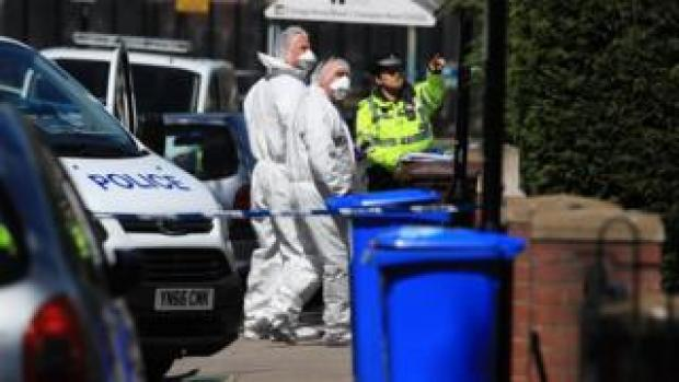 Forensic officers outside the house