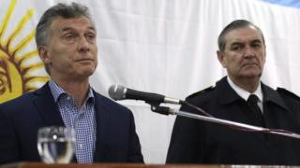 Argentine President Mauricio Macri (L) gestures next to Vice Admiral Marcelo Srur, during a press conference in Buenos Aires on 24 November 2017