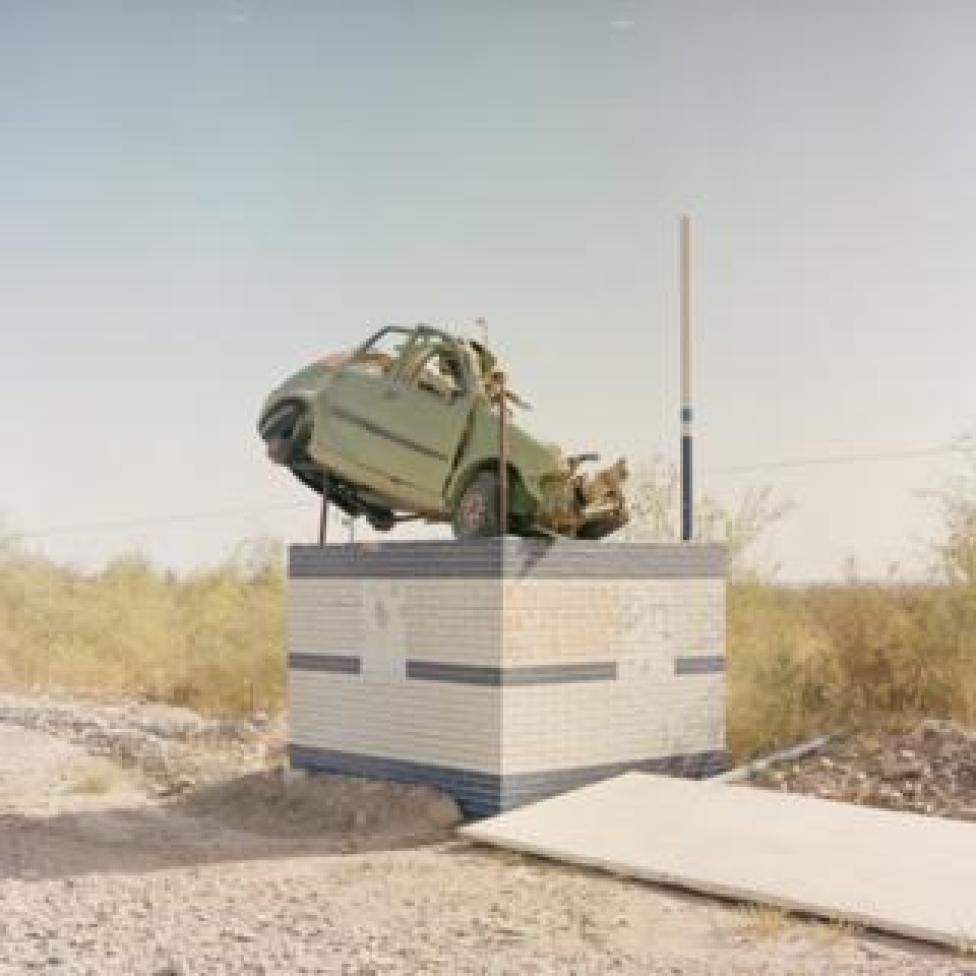 A car on a plinth to warn drivers